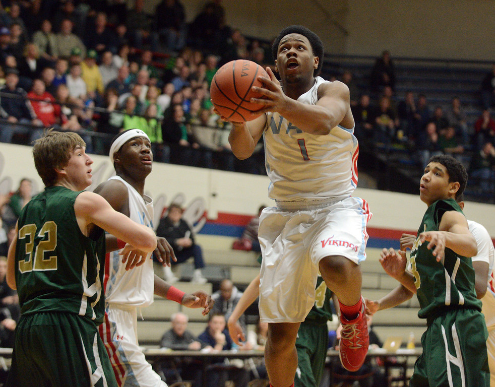 . Duncan Scott/DScott@News-Herald.com VASJ\'s Brian Parker drives to the basket in the first quarter. VASJ defeated Youngstown Ursuline 69-60 March 15 in the Division III regional final at Canton Memorial Fieldhouse.