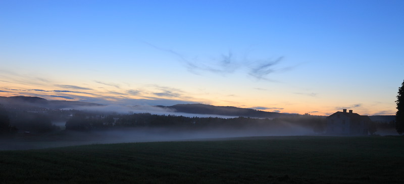 Mists rising from fields on a summer evening