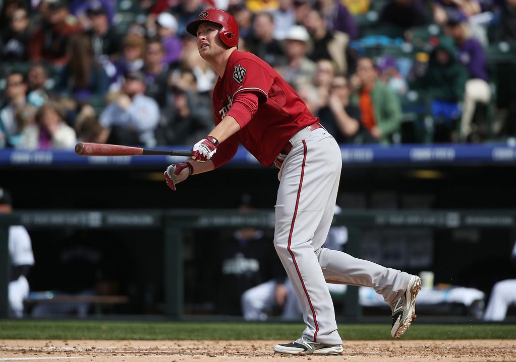 . Arizona Diamondbacks\' Mark Trumbo follows the flight of his two-run home run against the Colorado Rockies in the fifth inning of an MLB National League baseball game in Denver on Sunday, April 6, 2014. (AP Photo/David Zalubowski)