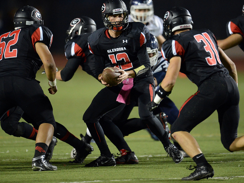 . Glendora quarterback Matt Fink (12) prepares to hand-off to Dillon Fink (31) in the first half of a prep football game at Citrus College in Glendora, Calif., on Thursday, Oct. 31, 2013.    (Keith Birmingham Pasadena Star-News)