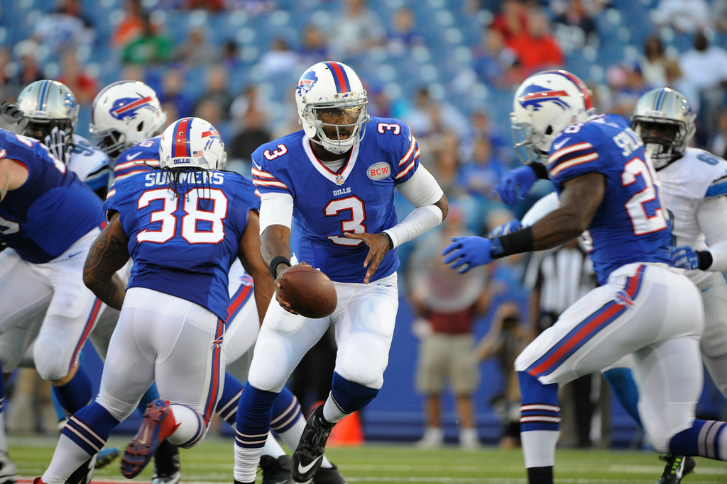 . Buffalo Bills quarterback EJ Manuel (3) prepares to hand off to running back C.J. Spiller (28) during the first half of a preseason NFL football game against the Detroit Lions, Thursday, Aug. 28, 2014, in Orchard Park, N.Y. (AP Photo/Gary Wiepert)