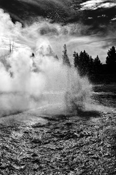 04 Mar 14.  Roughly 5 miles north from where yesterday's image was taken is found Lower Geyser Basin and Fountain Paint Pot. There is a boardwalk that takes you around the Paint Pot grouping of geysers which is handicapped accessible and thus easily reconnoitered, with lots of opportunity for getting some nice images, maybe even some great ones depending on the timing of your visit, the weather, and the cooperation of the thermal bed beneath your feet. The link above will provide you with a plethora of images from the area all in magnificent color, but color can sometimes distract from what is there. So I've taken the original color and converted it to B & W for today's submission. Now for those of you who go back a bit photographically, the mention of the Zone System, accredited to Ansel Adams, will be quite familiar, and for those of you who don't, here is a link to some background on the subject. If you are not familiar, I think you just might find this link to be of interest. Generally, this approach has been applied to film photography, but there is no reason why it shouldn't be equally applied in the digital world. One of the major players in the digital HDR realm has recently introduced his version of the Zone System approach to digital photography, which he discusses on his web page called Zone-Edit. For those of you who are seriously interested in digital B&W photography, may I subtly suggest you take a look at what he has to offer. I visited his web page a couple of weeks ago and decided that it was something I felt to be worthwhile; the submission for today is a result of spending some time with his material. What you see is the result of applying a curves adjustment layer for each zone in the image. I think the results should be obvious. This isn't going to be for everyone, but I feel certain that there are several of you who will find this material to be of value in your work. Nikon D300s; 18 - 200; Aperture Priority; ISO 200; 1/2000 sec @ f /10.