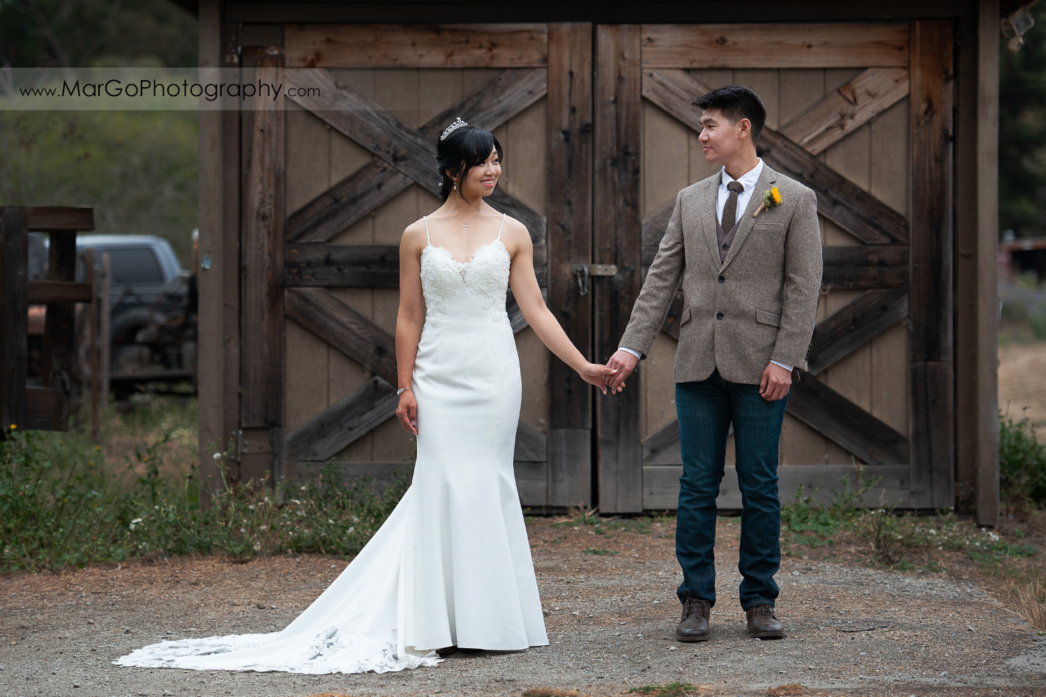 bride and groom standing holding hands at Long Branch Saloon & Farms in Half Moon Bay