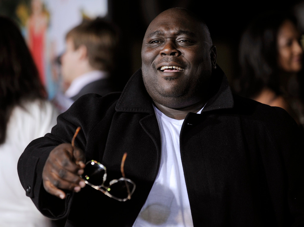 ". Faizon Love, a cast member in ""Couples Retreat,\"" banters with photographers at the premiere of the film in Los Angeles, Monday, Oct. 5, 2009. Love will be at the Cleveland Improv through Jan. 15. For more information, visit <a href=\""http://clevelandimprov.com/\"">clevelandimprov.com</a>.(AP Photo/Chris Pizzello)"