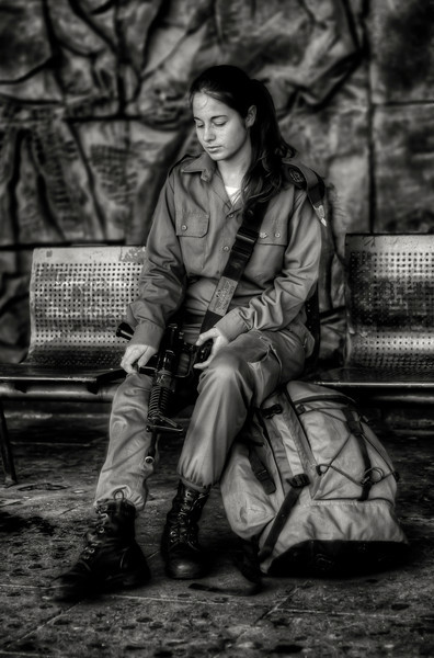 Ajdot 18 is currently doing her military service with the IDF. She waits for the bus early in the morning at the bus station in the Arab town of Akko. From here she will travel buy public bus to the border with Lebanon where she will carry out observation duties on the hostile neighbor. Although she is required to do a minimum of two years service, Ajdot would like to go for promotion and serve for an extra two years.  Akko, Israel, 2012.