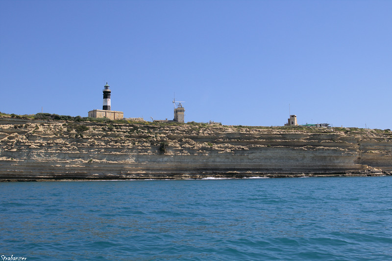 Malta.   Marsaxlokk Harbor    Lighthouse at Il-kalanka