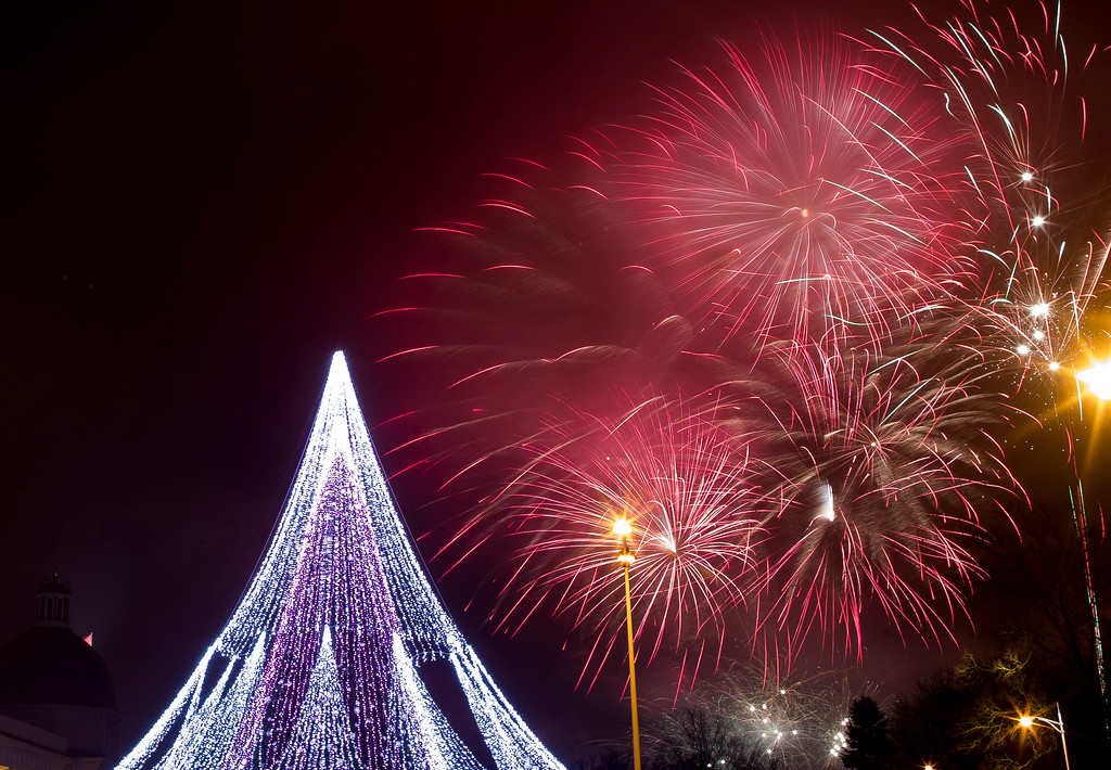 . Fireworks light the sky above illuminated Christmas tree at the Cathedral Square in Vilnius, Lithuania, shortly after midnight during the New Year\'s celebrations, Monday, Jan. 1, 2018. (AP Photo/Mindaugas Kulbis)