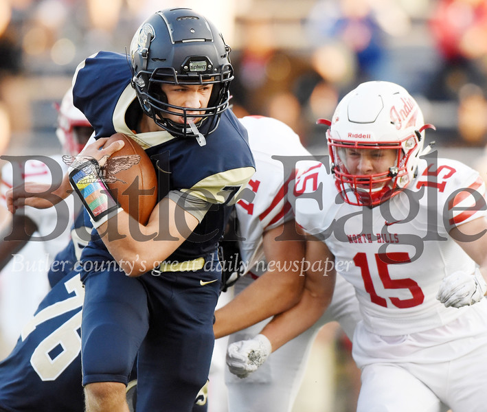 Harold Aughton/Butler Eagle: Butler's Cooper Baxter looks for running room during the first quarter against North Hill Friday, August 23.