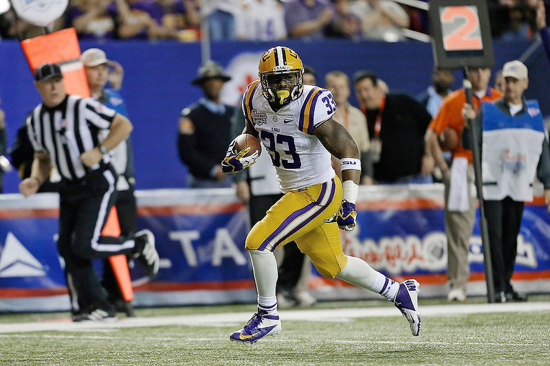 . LSU running back Jeremy Hill runs the ball into the end zone during the first half of the Chick-fil-A Bowl NCAA college football game against Clemson, Monday, Dec. 31, 2012, in Atlanta. (AP Photo/David Goldman)