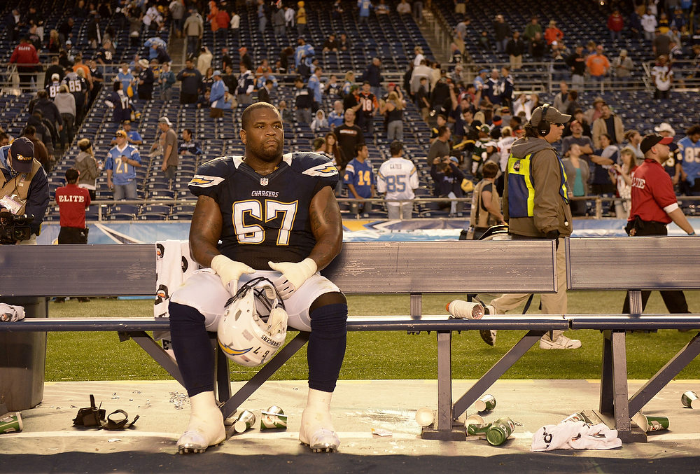 . Rex Hadnot #67 of the San Diego Chargers sits on the sidelines and looks onto the field after the game against the Cincinnati Bengals on December 2, 2012 at Qualcomm Stadium in San Diego, California. The Chargers lost to the Bengals 20-13. (Photo by Donald Miralle/Getty Images)