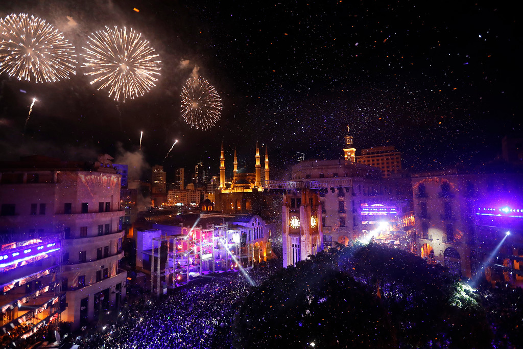 . Fireworks explode over the downtown Beirut, Lebanon, during New Year\'s celebrations, Monday, Jan. 1, 2018. (AP Photo/Hussein Malla)