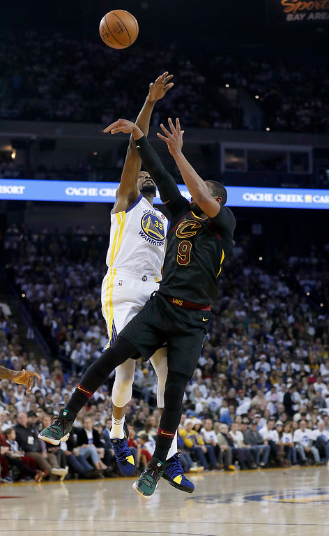 . Golden State Warriors forward Kevin Durant (35) blocks a shot by Cleveland Cavaliers guard Dwyane Wade (9) during the first half of an NBA basketball game in Oakland, Calif., Monday, Dec. 25, 2017. (AP Photo/Tony Avelar)