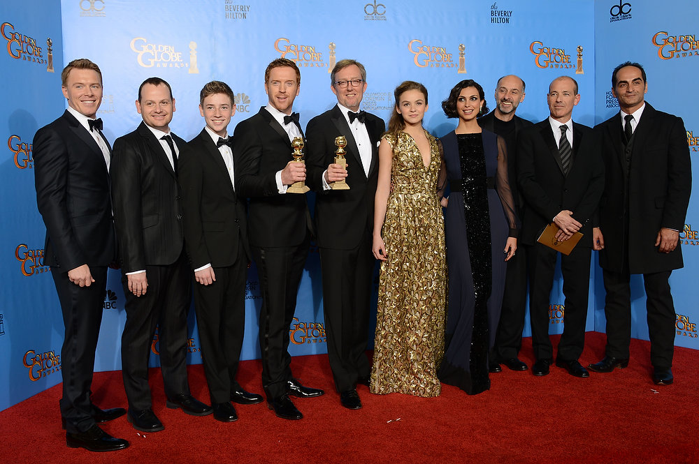. Actor Damian Lewis, center left, producer Alex Gansa, center right, and the cast and crew pose with the award for for best television series ñ drama for ìHomelandî backstage at the 70th Annual Golden Globe Awards at the Beverly Hilton Hotel on Sunday Jan. 13, 2013, in Beverly Hills, Calif. (Photo by Jordan Strauss/Invision/AP)