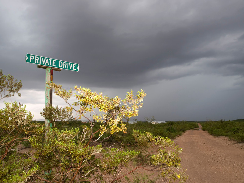 "A beautiful and photogenic place to visit during monsoon season. This shot saw me located east of Tucson in the Sierra Vista hills in search of monsoon storms. I was drawn to the colour from the yellow bush and sign, located in the middle of the desert landscape. The track or 'Private Drive' went on for ever straight into the storm. ""Sue me"" I thought. 