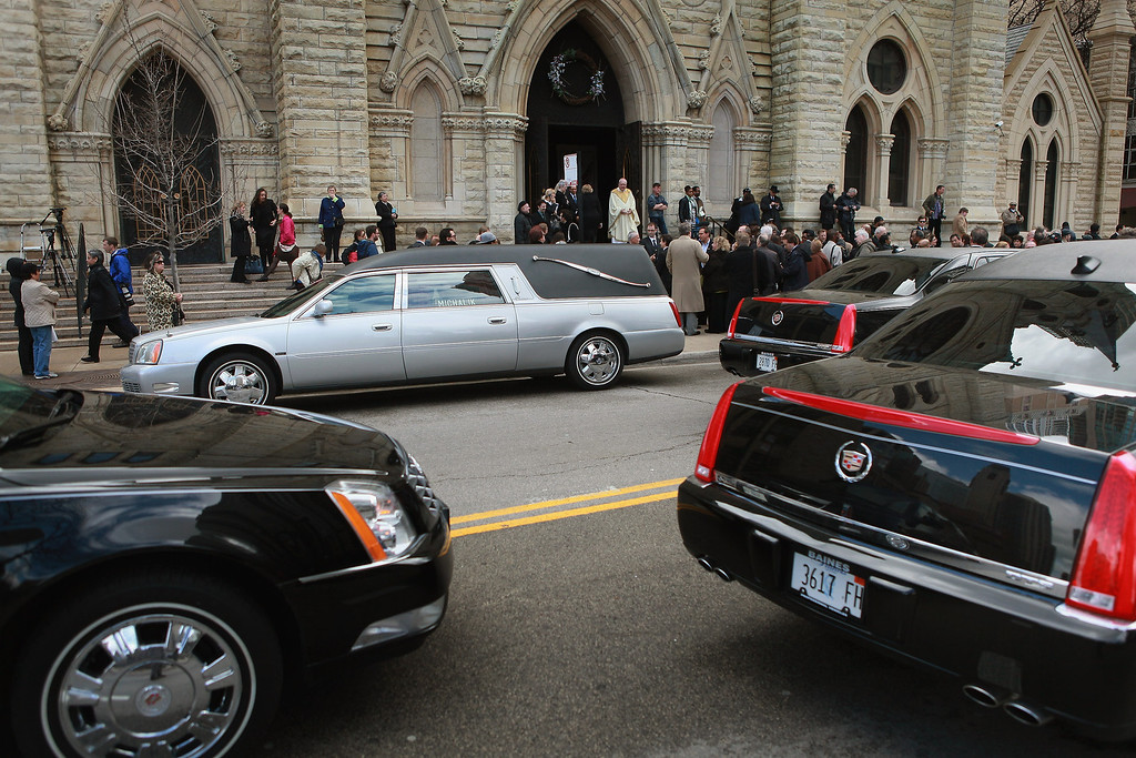 . CHICAGO, IL - APRIL 08: Mourners leave Holy Name Cathedral following a funeral service for film critic Roger Ebert April 8, 2013 in Chicago, Illinois. Ebert died April 4, at the age of 70, after a long battle with cancer.  (Photo by Scott Olson/Getty Images)