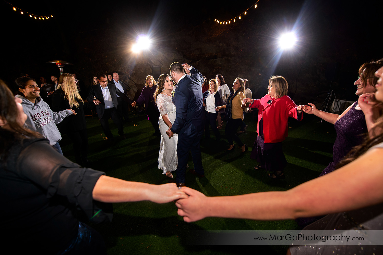 bride and groom dancing in the middle of guests circle during wedding reception at Saratoga Springs Cathedral Grove