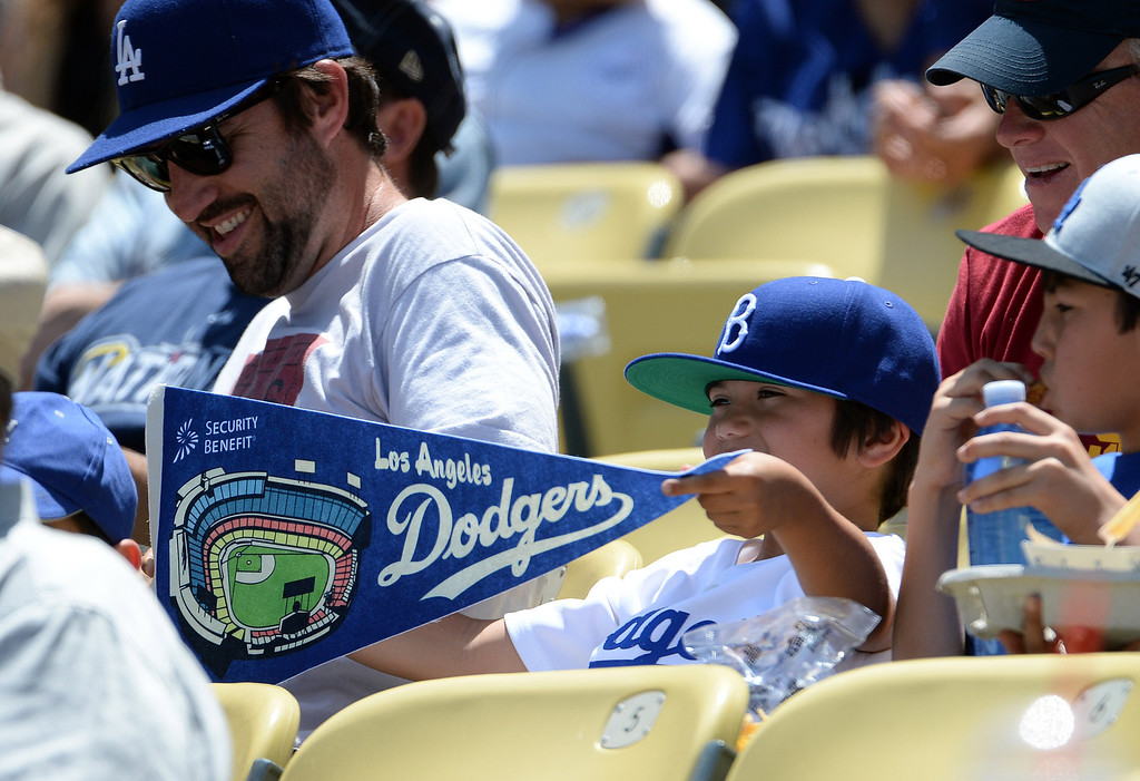 . A Los Angeles Dodgers fan with his pennant in the first inning of a Major league baseball game against the San Francisco Giants on Saturday, May 10, 2013 in Los Angeles.   (Keith Birmingham/Pasadena Star-News)