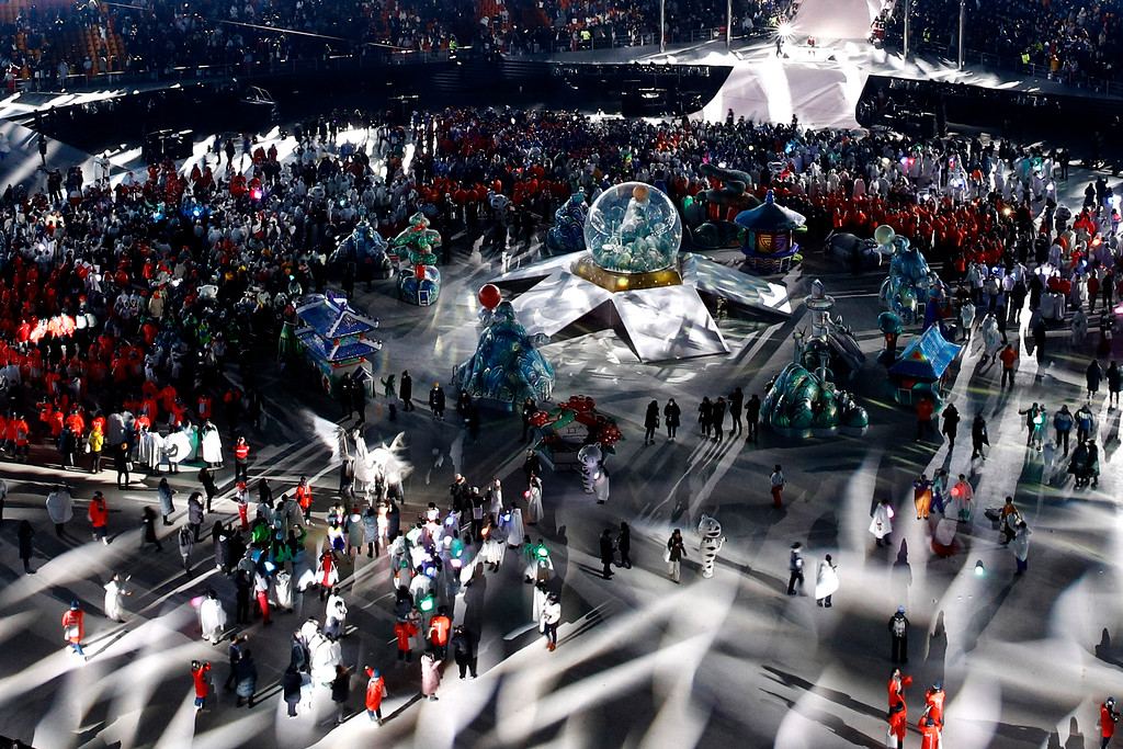 . Athletes and performers leave the closing ceremony of the 2018 Winter Olympics in Pyeongchang, South Korea, Sunday, Feb. 25, 2018. (AP Photo/Charlie Riedel)