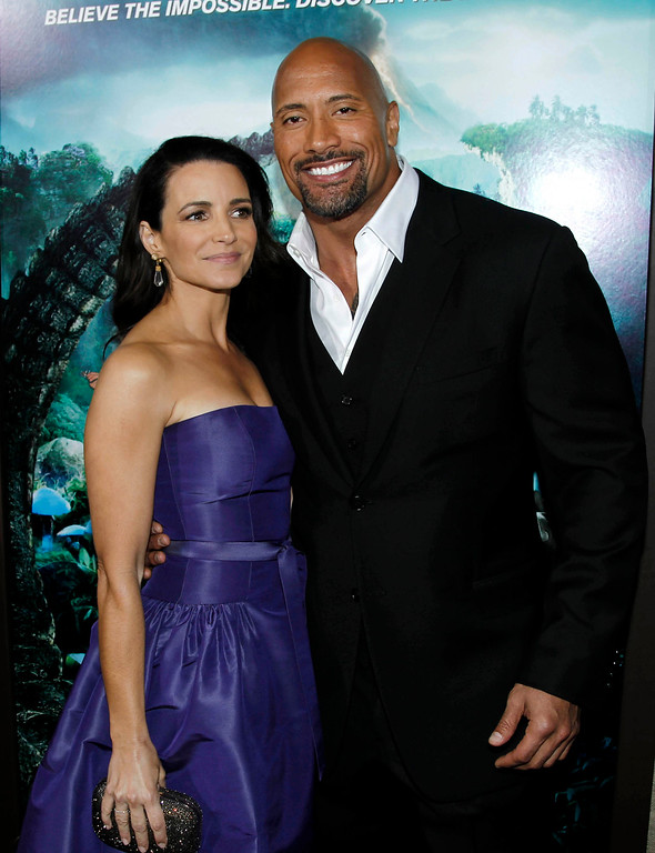 """. Cast members Dwayne \""""The Rock\"""" Johnson, right, and Kristin Davis pose together at the premiere of \""""Journey 2: The Mysterious Island\"""" in Los Angeles, Thursday, Feb. 2, 2011.  \""""Journey 2: The Mysterious Island\"""" will be released Feb. 10, 2011.  (AP Photo/Matt Sayles)"""
