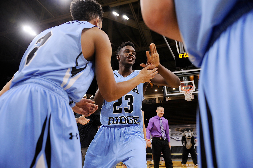 . Breon Michel (23) of Vista Ridge high fives teammates after being announced at the start of the game at the Coors Events Center on March 11, 2016 in Boulder, Colorado. (Photo by Brent Lewis/The Denver Post)