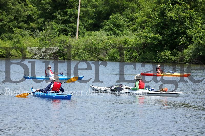 Senior center members enjoy the sunshine on Morraine State Park's Lake Arthur along with park guide and DCNR environmental education specialist Natalie Simon (front right).  Seb Foltz/Butler Eagle