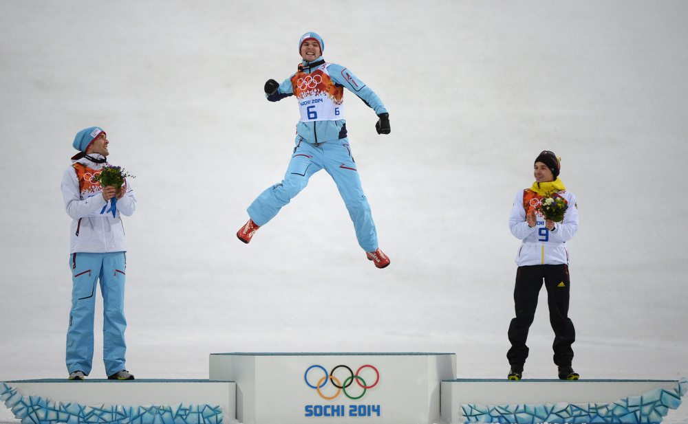 . (From L) Norway\'s silver medalist Magnus Hovdal Moan, Norway\'s gold medalist Joergen Graabak and Germany\'s bronze medalist Fabian Riessle celebrate during the Nordic Combined Individual LH / 10 km Flower Ceremony at the RusSki Gorki Jumping Center during the Sochi Winter Olympics on February 18, 2014. (PETER PARKS/AFP/Getty Images)