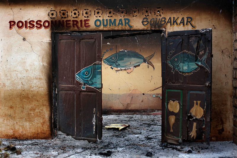 . A Muslim owned fish shop stands looted in the Miskin district of Bangui, Central African Republic, Tuesday Feb. 4, 2014. (AP Photo/Jerome Delay)