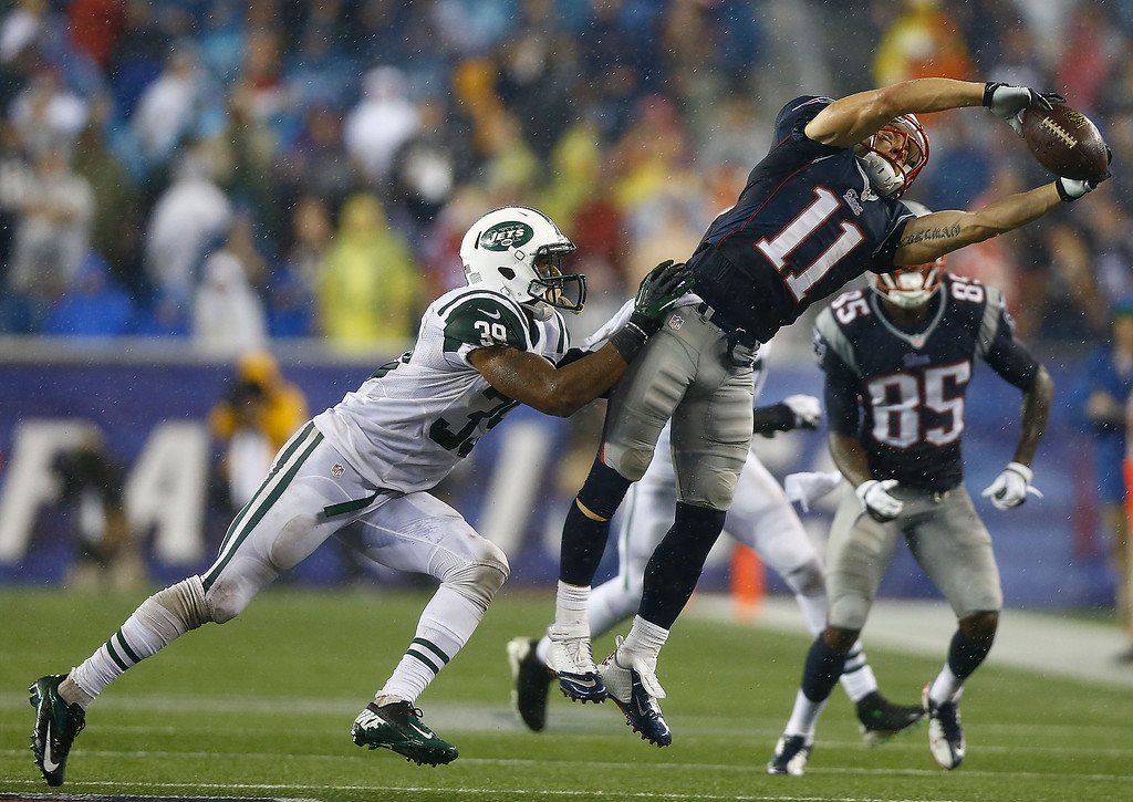 . Julian Edelman #11 of the New England Patriots catches a pass in front of Antonio Allen #39 of the New York Jets in the fourth quarter during the game at Gillette Stadium on September 12, 2013 in Foxboro, Massachusetts. (Photo by Jared Wickerham/Getty Images)