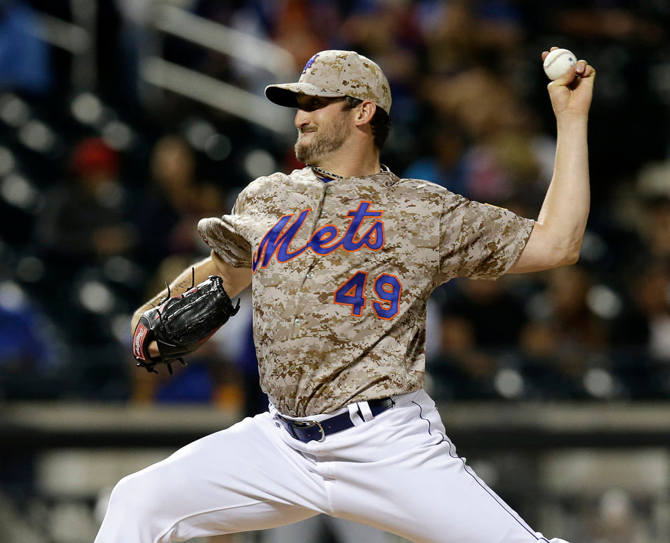 . New York Mets starting pitcher Jonathon Niese delivers in the fourth inning of a baseball game against the Colorado Rockies in New York, Monday, Sept. 8, 2014. (AP Photo/Kathy Willens)