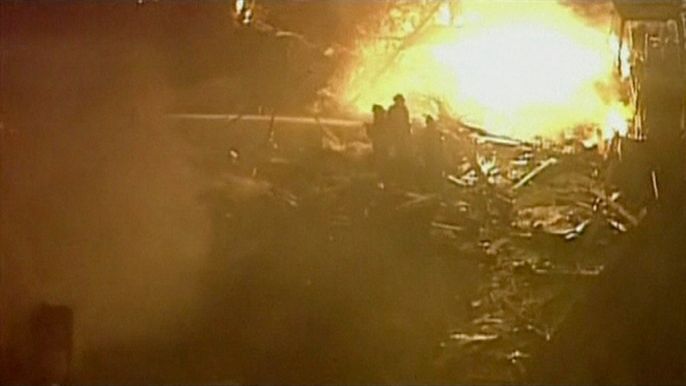Description of . A still image taken from a KHSB-TV video footage shows aerial of the flames and firefighters working at the scene of a fire at Kansas City, Missouri February 19, 2013. A fire triggered by a natural gas explosion that appeared to have originated underground engulfed a restaurant in Kansas City, Missouri, on Tuesday, injuring more than a dozen people, authorities and witnesses said.  REUTERS/KHSB-TV
