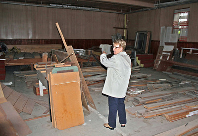Karen (Galey) Miller points to the old stage.