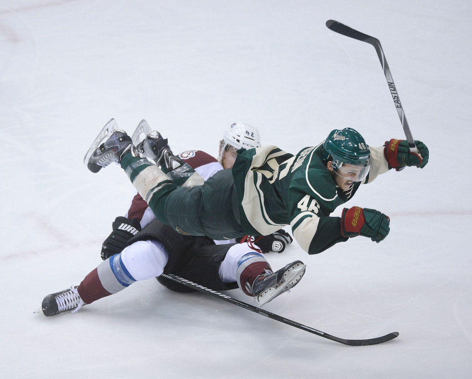 . Minnesota defenseman Jared Spurgeon went flying after he collided with Colorado center Brad Malone in the third period.  (Photo by Karl Gehring/The Denver Post)