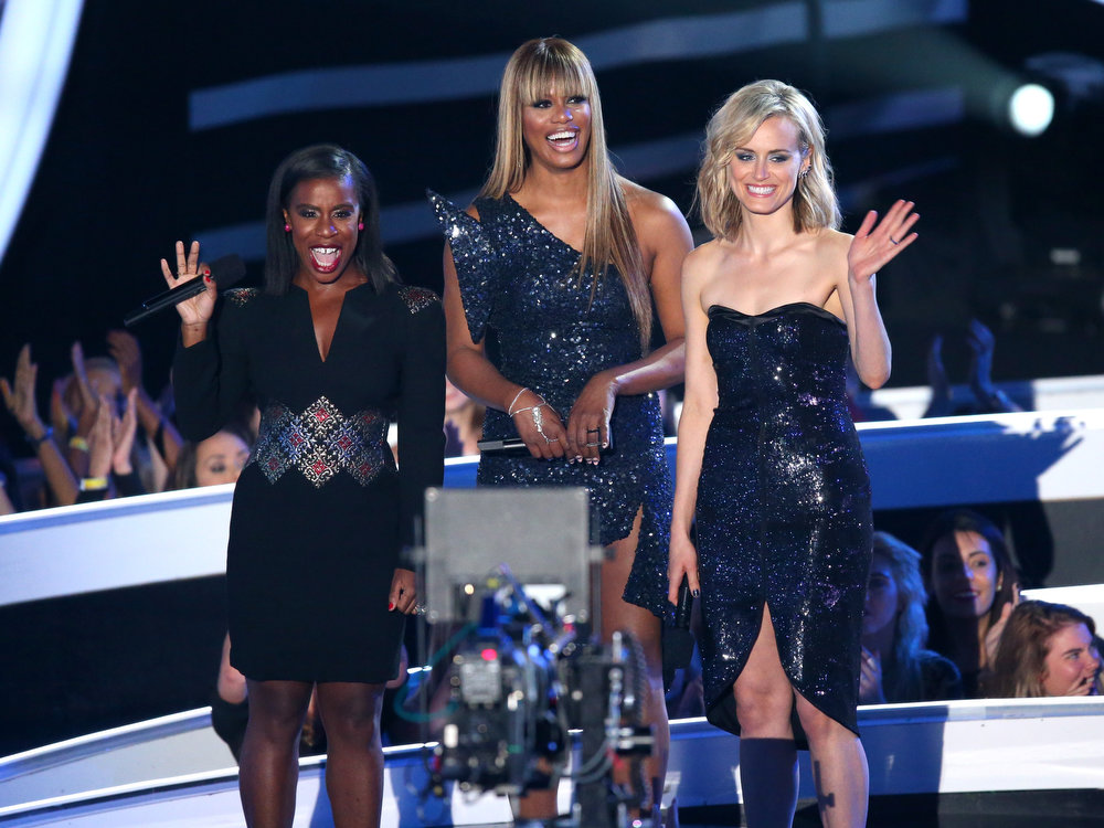 . (L-R) Actresses Uzo Aduba, Laverne Cox and Taylor Schilling speak onstage during the 2014 MTV Video Music Awards at The Forum on August 24, 2014 in Inglewood, California.  (Photo by Mark Davis/Getty Images)