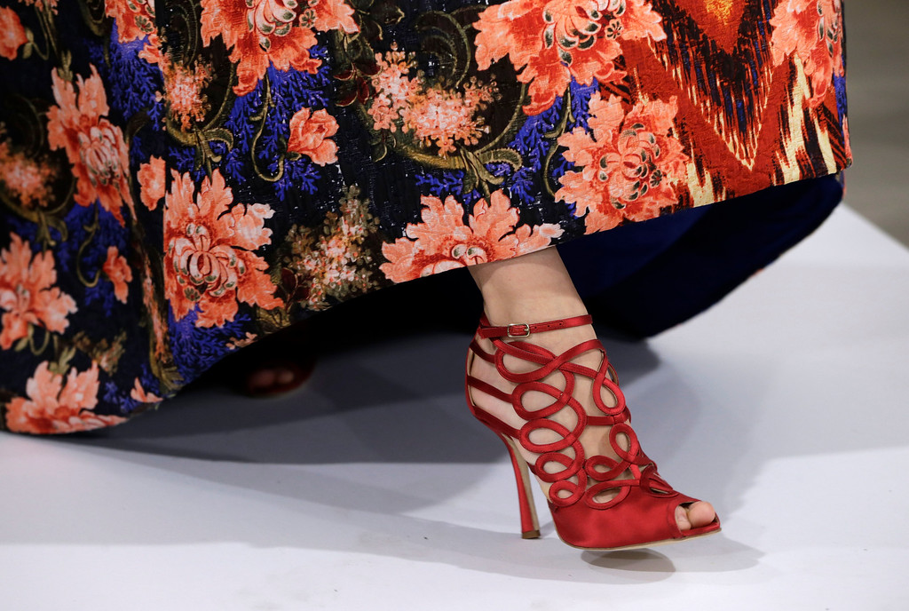 . In this Feb. 12, 2013, file photo, fashion from the Oscar de la Renta Fall 2013 show is modeled during Fashion Week in New York. (AP Photo/Kathy Willens, File)