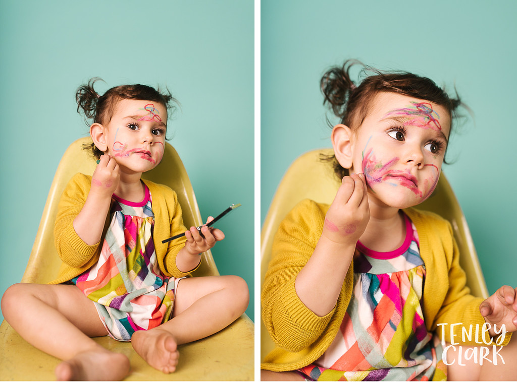 Playful studio portraits of toddler doing their own makeup on colorful backdrops. Commercial photography by Tenley Clark.
