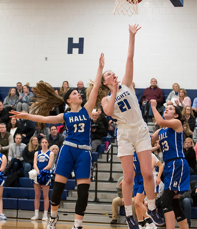 01/28/20 Wesley Bunnell | StaffrrSouthington girls basketball defeated Hall in a home contest on Tuesday night. Madison Hulten (21).