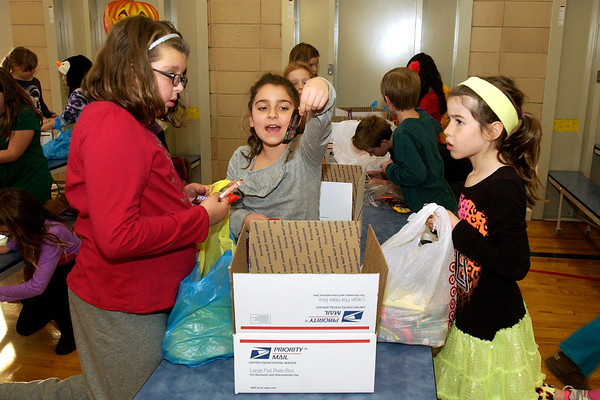 Kids Club packs Halloween candy for troops