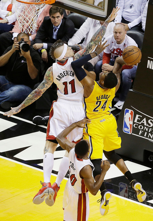 . Indiana Pacers small forward Paul George (24) heads to the hoop as Miami Heat power forward Chris Andersen (11) defends during the first half of Game 7 in their NBA basketball Eastern Conference finals playoff series, Monday, June 3, 2013 in Miami. (AP Photo/Wilfredo Lee)