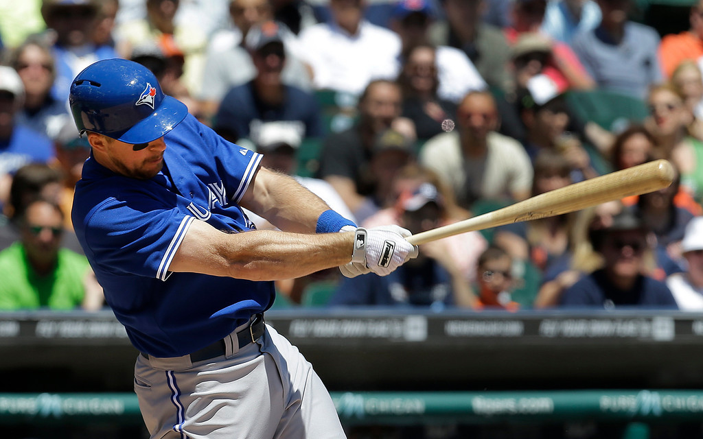 . Toronto Blue Jays\' Erik Kratz hits a two-run single against the Detroit Tigers in the fourth inning of a baseball game in Detroit, Thursday, June 5, 2014. (AP Photo/Paul Sancya)