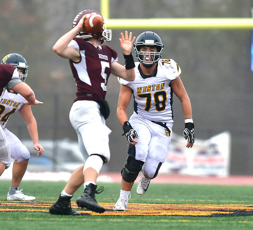 12/14/2019 Mike Orazzi | StaffrWeston's Daniel McGuire (78) and Killingly's Jacob Nurse (5) during the Class M State final at Veteran's Stadium in New Britain on Saturday.