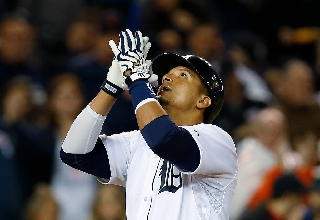 . Detroit Tigers\' Victor Martinez reacts to hitting a solo home run against the Houston Astros in the sixth inning of a baseball game in Detroit, Wednesday, May 7, 2014. (AP Photo/Paul Sancya)