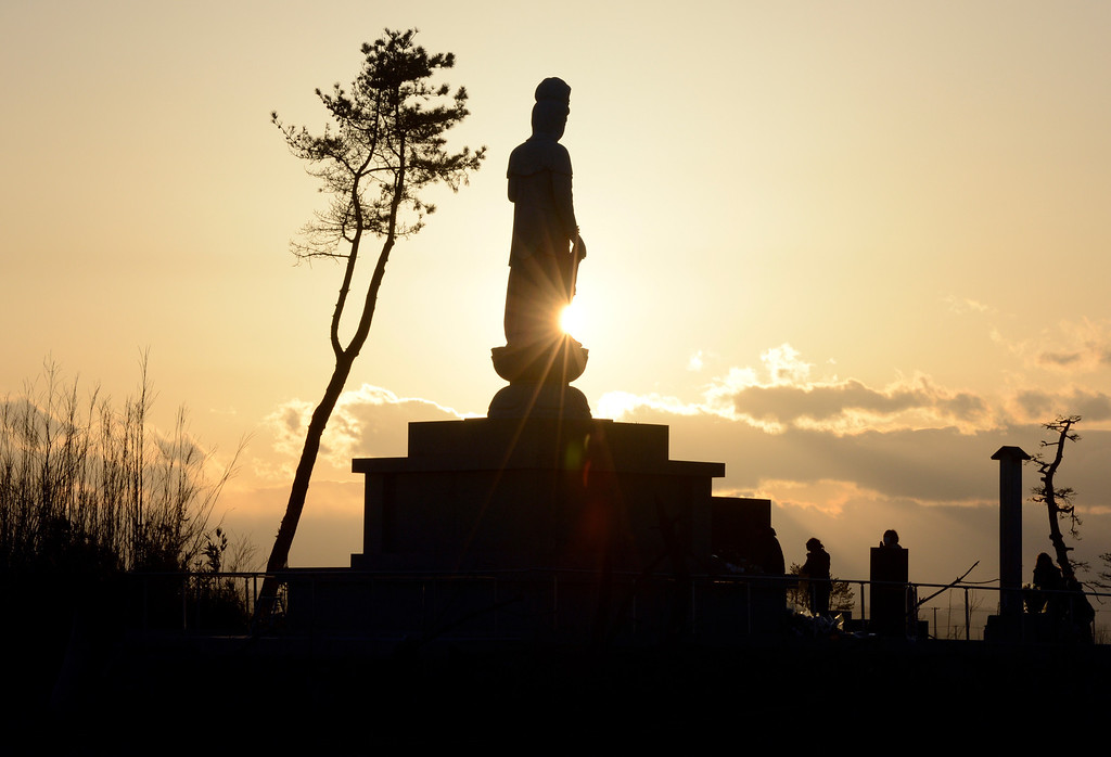 . A Buddhist statue recently built in honor of tsunami victims is silhouetted at sunset on the seashore in Arahama district in Sendai, Miyagi Prefecture on March 11, 2013 on the second anniversary of the March 11, 2011 earthquake and tsunami disaster. Japan on March 11 marked the second anniversary of a ferocious tsunami that claimed nearly 19,000 lives and sparked the worst nuclear accident in a generation.  AFP PHOTO/Toru YAMANAKA/AFP/Getty Images