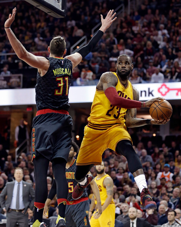 . Cleveland Cavaliers\' Lebron James (23) looks to pass against Atlanta Hawks\' Mike Muscala (31) in the first half of an NBA basketball game, Friday, April 7, 2017, in Cleveland. (AP Photo/Tony Dejak)
