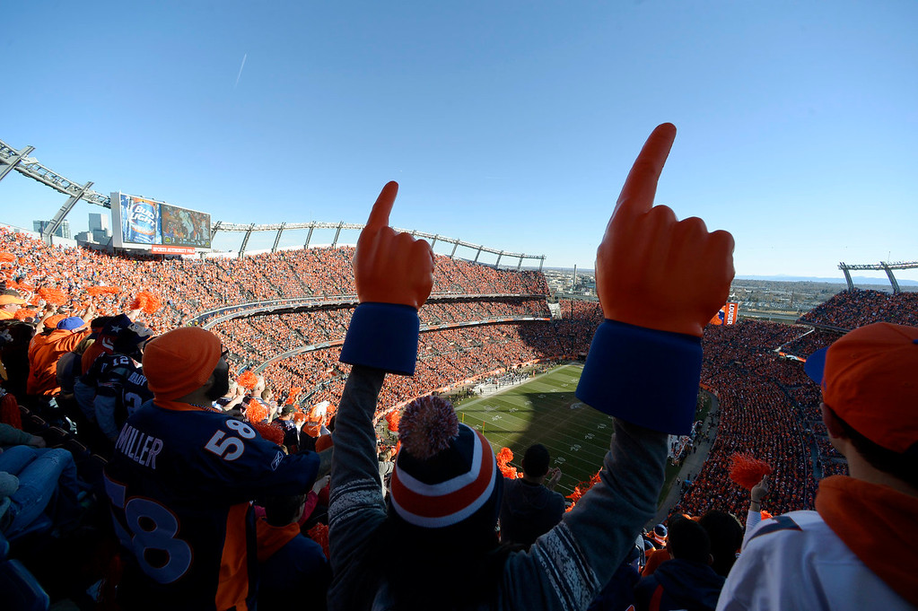 . Broncos fans cheer during the second half of the game.  The Denver Broncos vs. The New England Patriots in an AFC Championship game  at Sports Authority Field at Mile High in Denver on January 19, 2014. (Photo by Craig Walker/The Denver Post)