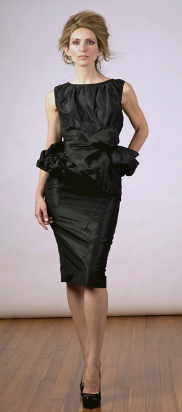 Silk taffeta top with removable cowl, matching skirt with hand-stitch details.