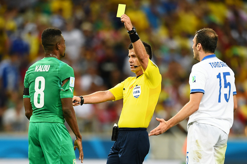 . Salomon Kalou of the Ivory Coast is shown a yellow card by referee Carlos Vera during the 2014 FIFA World Cup Brazil Group C match between Greece and the Ivory Coast at Castelao on June 24, 2014 in Fortaleza, Brazil.  (Photo by Laurence Griffiths/Getty Images)
