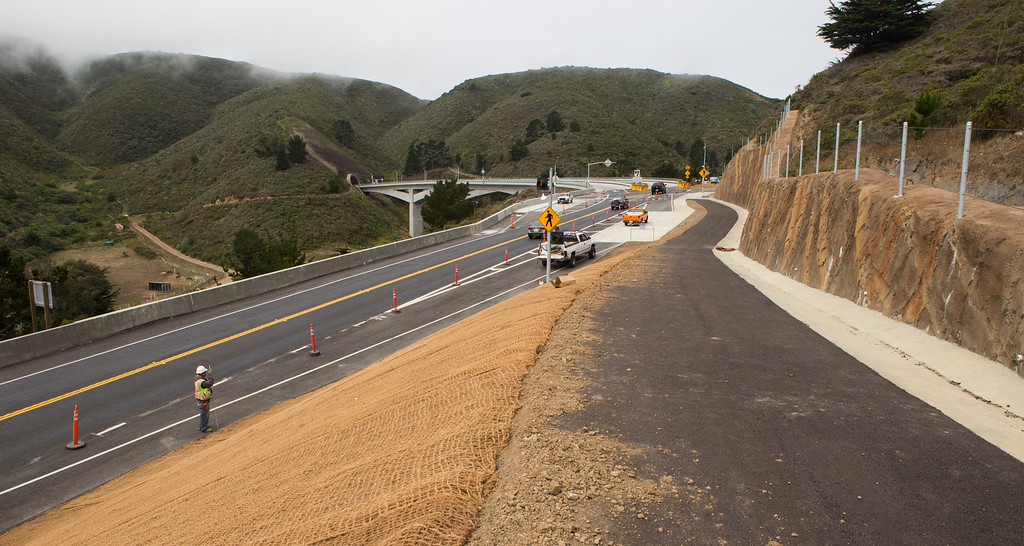 . Construction crews work on the new biking and hiking trail near the north end of the Devils Slide Bypass Tunnels, south of Pacifica, Calif., on Tuesday, July 23, 2013.(John Green/Bay Area News Group)