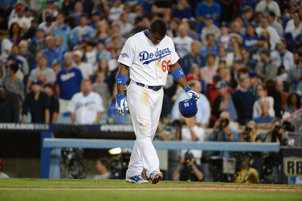 . The Dodgers\' Yasiel Puig hangs his head after hitting in to a double play in the 9th inning against the Cardinals during game 4 of the NLCS at Dodger Stadium Tuesday, October 15, 2013. The Cardinals defeated the Dodgers 4-2. (Photo by David Crane/Los Angeles Daily News)