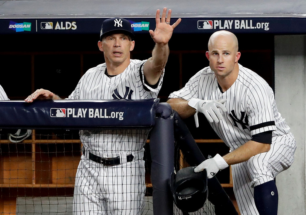 . New York Yankees manager Joe Girardi, left, motions to the batter during the third inning in Game 3 of baseball\'s American League Division Series against the Cleveland Indians, Sunday, Oct. 8, 2017, in New York. (AP Photo/Frank Franklin II)