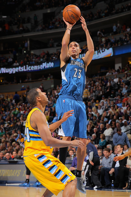 . DENVER, CO - NOVEMBER 15:  Kevin Martin #23 of the Minnesota Timberwolves takes a shot over Andre Miller #24 of the Denver Nuggets at Pepsi Center on November 15, 2013 in Denver, Colorado. (Photo by Doug Pensinger/Getty Images)